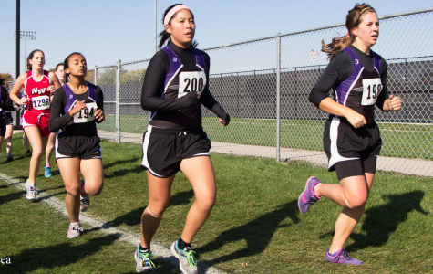 Girls cross country sprint to the end