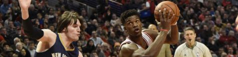 Dec 27, 2014; Chicago, IL, USA; Chicago Bulls guard Jimmy Butler (21) drives to the basket while defended by New Orleans Pelicans forward Luke Babbitt (8) during the first half at United Center. Mandatory Credit: David Banks-USA TODAY Sports ** Usable by BS, CT, DP, FL, HC, MC, OS, HOY, CGT and CCT **