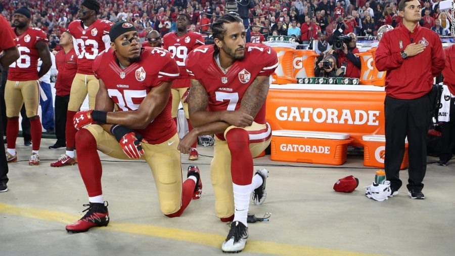 Kaepernick+takes+a+knee+during+the+national+anthem