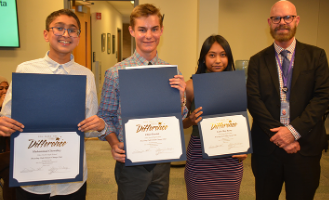 "(left to right: Muhammad Chowdhry, Elliot Parrish, Lanie Mae Rasay, & James Edwards at Board Meeting.) ""Niles North Principal James Edwards recognized three students who are creating awareness throughout the school about environmental issues."" District 219 announcement said."