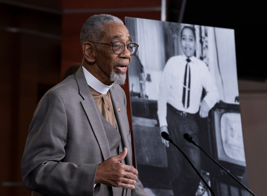 U.S. Representative Bobby L. Rush speaks during a conference about the anti-lynching act beside a picture of young Emmett Till.