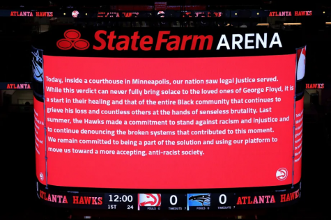 The Atlanta Hawks and Orlando Magic observe the guilty verdicts in the Derek Chauvin case prior to the game. (Photo courtesy of Chicago Sun Times)
